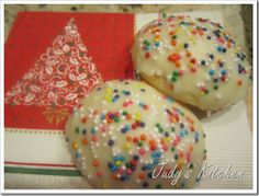 Italian Anise Cookies -- A soft, cakey, not-so-sweet cookie flavored with vanilla, lemon and anise. The fabulous anise-flavored glaze is topped with crunchy nonpareils.