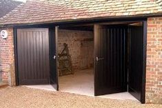 Bifold garage doors, like any other type of door, have their own advantages and disadvantages. Learn here about the two types of folding garage doors. Garage, Doors, Garage House, Modern Garage, Bifold Doors, Garage Doors, Garage Door Design, Diy Door, Diy Garage Door