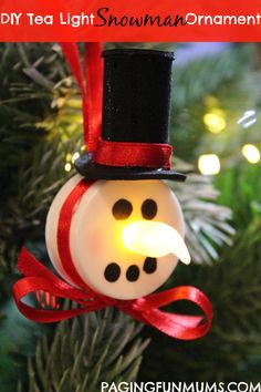 Tea Light Snowman Ornament! Could also be used to pin to a name tag or lanyard while at work.  Hot glue a safety pin to back away from the on/off switch.