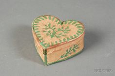 Cut Paper Decorated Heart-shaped Box, America, second quarter 19th century, with cut-work pink flowers and green leaves applied to a plain paper ground, ht. 1 5/8, wd. 3 3/8, dp. 3 in.