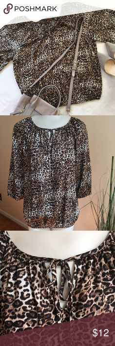 """Ellen Tracy Cheetah Print Blouse Ellen Tracy cheetah print blouse. Size: large. In excellent used condition, no rips or stains from smoke free/ pet free home. 3/4 sleeves, with elastic band. Material: 100% polyester. Sleeve length: 20"""". Armpit to armpit: 24"""". Overall length: 22"""". Reasonable offers welcome. Ellen Tracy Tops Blouses"""