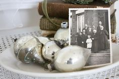 I love this idea: fill a tray with vintage ornaments and an old black and white family photo, via: