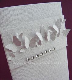 Love the white on white but this would also be a great card with different colored butterflies and rhinestones.