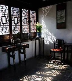 Timber lattice windows and their shadows on the floor in a Suzhou garden residence. via TW by All Things Chinese 