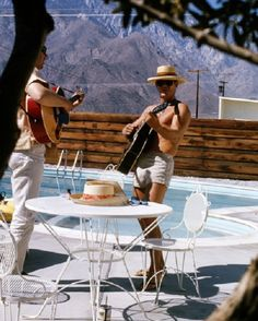 Musician Billy Strange at Steve McQueen's house in Palm Springs to teach him to play the guitar for his character in Baby, The Rain Must Fall, 1963.