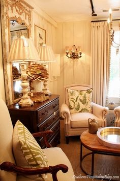 board and batten, chair, lamps, gorgeous mirror, fern pillow - love everything in this shop!  Francie Hargrove in NC