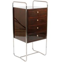 Czech Deco Chrome-and-Walnut Chest of Drawers | From a unique collection of antique and modern commodes and chests of drawers at https://www.1stdibs.com/furniture/storage-case-pieces/commodes-chests-of-drawers/