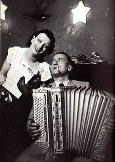 Kiki and her accordionist by George Brassai