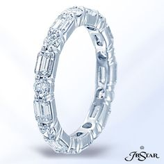 Style 7296 Platinum diamond eternity band beautifully designed with round and emerald cut diamonds in an alternating pattern.