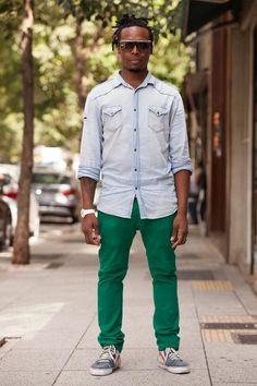 green pants denim shirt black guy