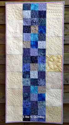 Beautiful table runner with spectacular free motion quilting by Bente  source:  I like to quilt blog