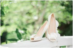 brides wedding shoes on rail of chapel at the whitestone inn