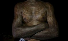 """Mahettar Ram Tandon, 76, a follower of Ramnami Samaj, who has tattooed the name of the Hindu god Ram on his full body, poses for a picture inside his house in the village of Jamgahan, in the eastern state of Chhattisgarh, India, November 17, 2015. """"It was my new birth the day I started having the tattoos,"""" Tandon said. """"The old me had died."""" """"The young generation just don't feel good about having tattoos on their whole body,"""" he added. """"That doesn't mean they don't follow the faith.""""…"""