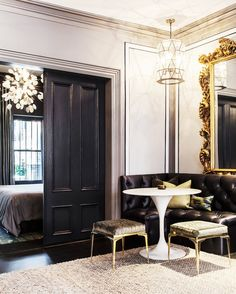 7 Essentials for a Beautiful Dining Space// a tufted banquette with an oversized mirror