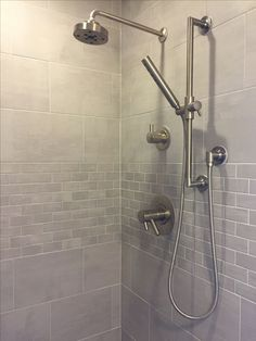 It took years. Finally tiled shower. Daltile Skybridge in gray.