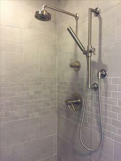 It took years. Finally tiled shower. Daltile Skybridge in gray.