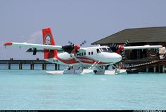 One of only two Twotters wearing the new livery for the now merged Trans Maldivian Airways and Maldivian Air Taxi. The other being 8Q-MAN. The PT6A turboprops, each producing 550 shp are fired up ready for her 45 minute flight back to Male transferring holiday makers for their connecting flights. Trans Maldivian Airways - TMA De Havilland Canada DHC-6-300 Twin Otter  Off-Airport - Meedhupparu Island Maldives, March 22, 2014