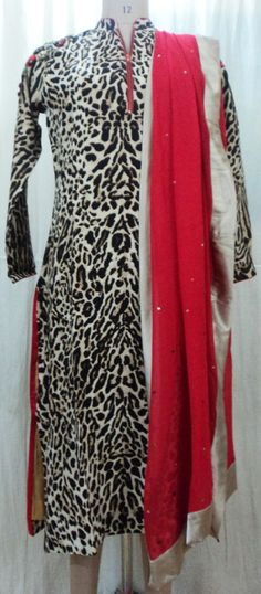 Bring it on your animal instinct....Welcome this New Year with Silk Crepeon' Animal Printed Kurta with 3-D Floral Sequinned Embroidery on Shoulders and Front Zipper Detailing with a Touch of Bright Red All over and Teamed up with a Sequinned Red Dupatta....All by AVEN #animalprint #winterwear #indiandesign #designwear #chic #AVEN