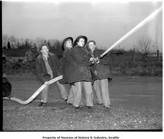 Women volunteer fire fighters at Des Moines, Washington, January 1952