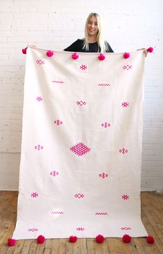 Moroccan Pompom Throw – Neon Pink Motifs from Baba Souk