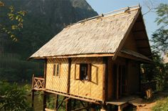 Nong Kiau Riverside Bungalows perched on the Nam Ou River - 4 hours by car or boat from Luang Prabang.