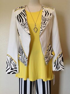We cannot get over how fun and trendy this little jacket is! From the zebra print and bright yellow trim to the collar and flared sleeves, this piece is picture perfect! - Insight - Black and white faux leather jacket with yellow trim  - #Casanovasdownfall #SpringFashion #Style #Trendy #ZebraPrint