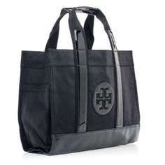 Tory Burch nylon tote. Used. Looks worn. White marks on leather straps that can be easily fixed. Tory Burch Bags Satchels