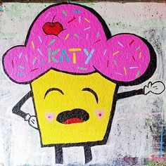 My husband found my mascot graffiti'd on the canal today! So close; if only they'd spelt my name right!  Sadly can't tag the artist as there isn't a full name.  Do you like graffiti art? I love seeing it down the canal. . [Image description: graffiti on a white washed wall of a large smiling cupcake with bright pink icing & the name Katy written on the icing]. . . . . . . #graffiti #graffitiart #streetart #urbangraffiti #urbanstreetart #cupcake #cartooncupcake #cutegraffiti #leeds…