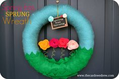 """This was a post I did last year for Craft-O-Maniac that never made it on my own blog! Here's my spring wreath from 2012! I'm currently working on my new 2013 wreath, but in the meantime enjoy! I thought I'd start spring off right by making a """"Spring Has Sprung"""" wreath for my front door! …"""