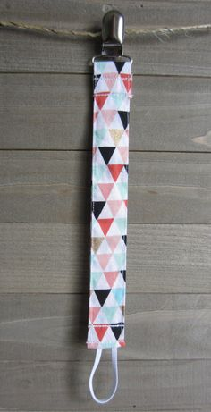 Hey, I found this really awesome Etsy listing at https://www.etsy.com/listing/386718544/pink-gold-mint-triangle-pacifier-clip