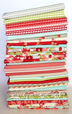 Ruby, by Moda. I am so incredibly inspired by this collection. It's the basis for my cake display next week. I bought 7 of the patterns tonight. Just beautiful!