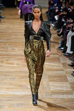 Deep-V in a structured leather top at Balmain Fall 2013 #runway #fashionweek