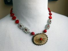 Victorian Brooch Necklace, Assemblage, Carved Coral, Rhinestone, Vintage Repurposed, Recycled, Upcycled by Vinchique on Etsy https://www.etsy.com/listing/188269797/victorian-brooch-necklace-assemblage