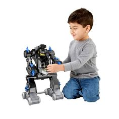 """The Imaginext Remote Control Transforming BatBot is sure to bring young superheroes hours of fun! This two in one BatBot is a tank and a robot all rolled into one! This crime-fighting robot transforms to a cool """"armoured"""" tank and back again just by turning the disk on the Bat Bot or by using the full-function remote control. Besides an awesome transformation, kids can continue the action by activating the claw or launching disks at their favourite Gotham City villains! (Villains sold…"""