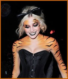 Maybe I'll be a tiger for Halloween. I like the idea of being a cat but everybodies a cat, & I love tigers so...
