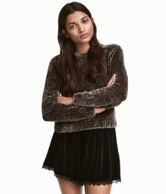 Dark gray. Short sweater knit in soft chenille yarn with long raglan sleeves.