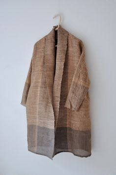 Look up Amy Revier (weaver and artist sculpting garments): this is ThulmaCoat LightPersimmon