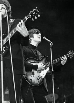 The Beatles, George Harrison, and John Lennon, perform at the Empire Pool, Wembley, May 1966. Photo © 2014 Hollywood Archive/The Grosby Group