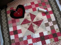 Pink and brown doll quilt by Kathleen Tracy http://www.countrylanequilts.com/