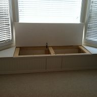I have been envisioning this for our bay window for months!  And here's a tutorial, step by step.  DIY bay window flip top storage bench.