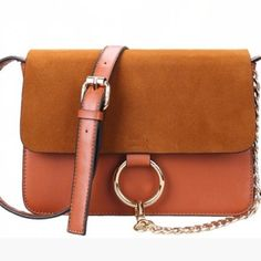 ✨one day sale✨Chloe Faye look a like bag in brown Brown crossbody with gold hardware. Looks just like the real one. The bags look better stuffed. Super cute and the hottest bag at the moment. Real one goes for $1400. Not Chloe.   IT bag of the year. Worn by fashion bloggers and celebs. Not branded. Not counterfeit. 9w x 7h x 3.5d   not Topshop. Also available in gray look for listing on my page. Get your fill without spending a small fortune.  lowest price. Someone is selling this bag for…