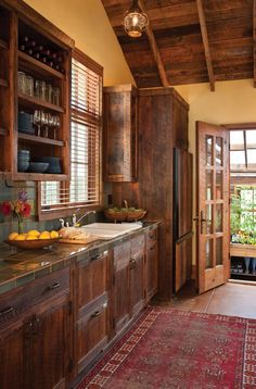 pretty kitchen with barnwood cabinets