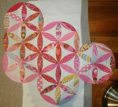 Putting together rows of Joseph's Coat quilt tutorial by Don't Look Now!