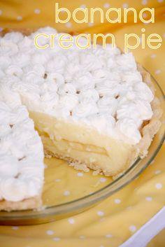 nana banana cream pie 1/3 c. cornstarch 2/3 c. white sugar 3 egg yolks 3 c. hot milk 2 ripe bananas whip cream topping