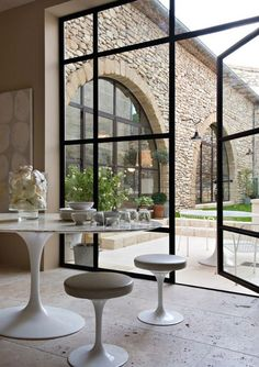 Glass is not only a remarkable product to reshape, it opens our viewpoint and produces a visual bridge to our home's surroundings.