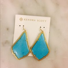 "Kendra Scott Alexandra Large Magnesite Earrings Kendra Scott ""Alexandra"" drop earrings. Approx. 2""L; 1.4""W. 14-karat gold-plated brass hardware. Signature arabesque-shaped beaded frame. Prong-set magnesite turquoise center. French wire. Imported. Color: Magnesite Drop Earrings, Turquoise/ Golden Kendra Scott Jewelry Earrings"
