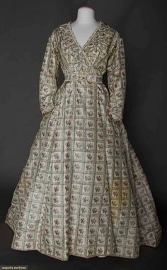 "Maternity Dress, c1865, One-piece printed cream silk taffeta in windowpane pattern with chine rosebud centers, ruched self fabric trim, entirely lined in cream cotton, center-back skirt cartridge pleated, Back 38"", Waist 34"", Length 57-75"", includes one boned evening bodice and waistband, (originally 2-piece dress, skirt pleats let out in front, bodice attached to skirt for maternity wear"