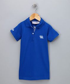 Mini sports fans will be ready to cheer on their favorite team when wearing this darling and sporty polo dress. The easy-to-wear piece hits just above the knee and features an embroidered team logo and a two-button closure—perfect for reenacting the game-winning play in the living room!