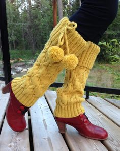 Free Knitting Pattern for Mosey Legwarmers - Susan Power's adorable leg warmers feature slightly flared (boot bottomed) to fit over shoes, an all-over cable pattern, ribbed cuffs, and pompom ties. Pictured project by margrietaasman who added a ribbed cuff at the bottom.