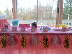 Sweets table at a pink and gold princess party